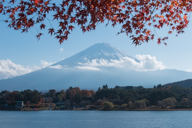 Mountain mt. fuji and lake in japan with blue cloud sky and red maple tree Premium Photo