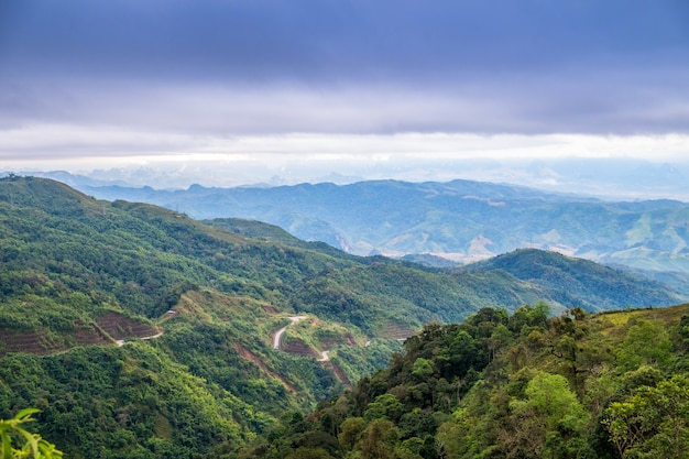 Mountain with sky scenery between the way Premium Photo