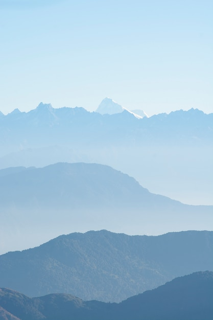 Mountains peaks in mist, blue shade of mountains, north sikkim, india Premium Photo