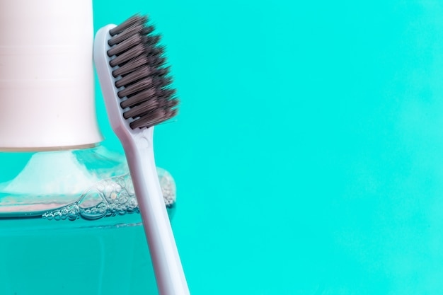Mouthwash and toothbrush for healthy care oral cavity Premium Photo