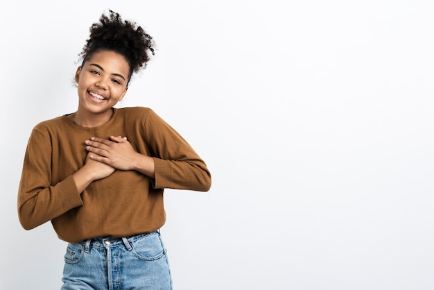 Moved woman posing with hands on chest Free Photo