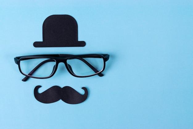 Movember mustache awareness background with  glasses. Premium Photo