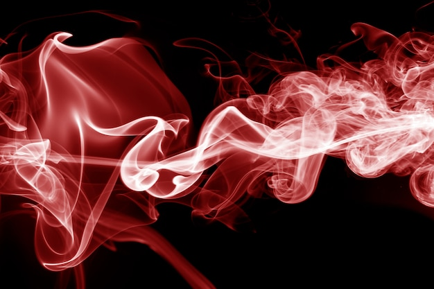 Movement of red smoke on black background. Premium Photo