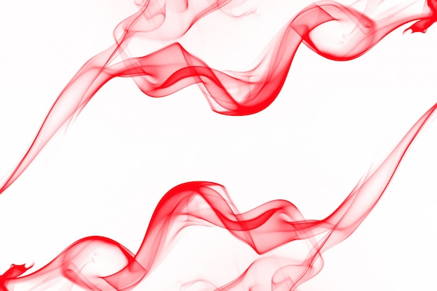 Movement of smoke abstract isolated on white background, red ink water Premium Photo