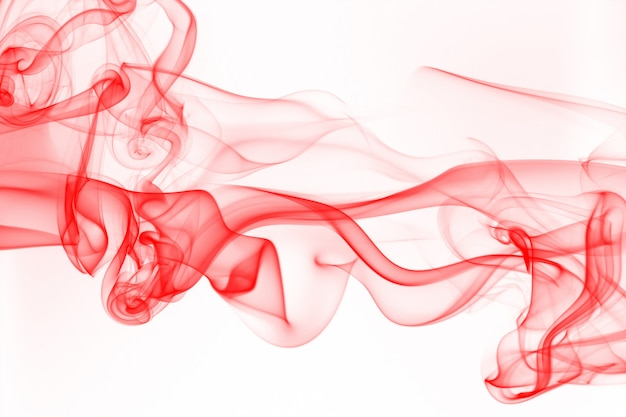 Movement of smoke, abstract red smoke on white background, ink water Premium Photo