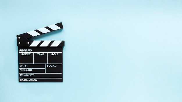 Movie clapper on blue background with copy space Premium Photo