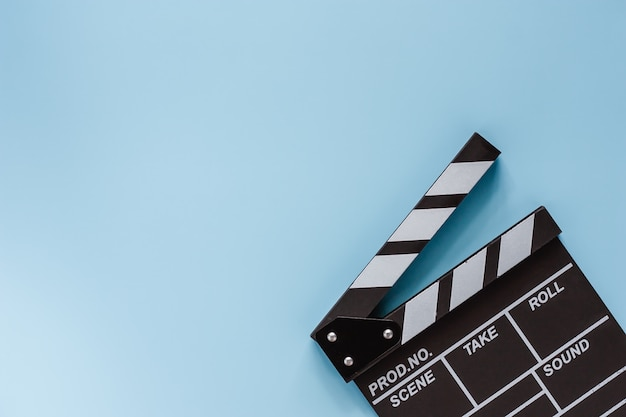 Movie clapper board on blue for filming equipment Premium Photo