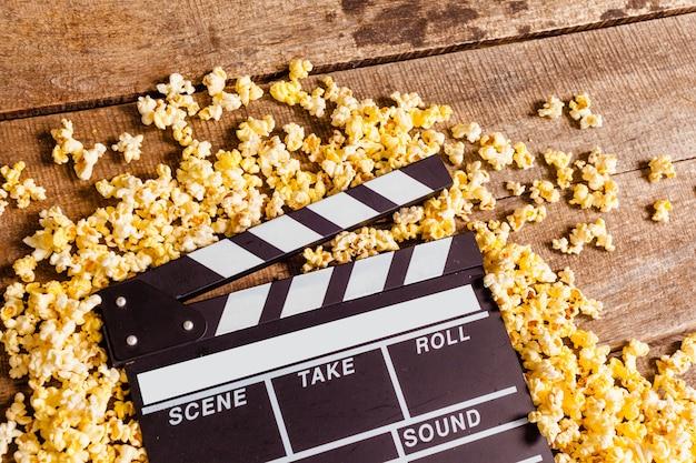 Movie clapper board and pop corn Premium Photo