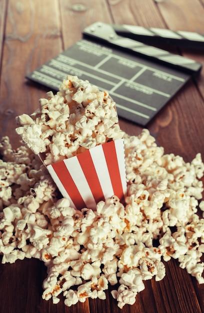 Movie clapper board in popcorn Premium Photo