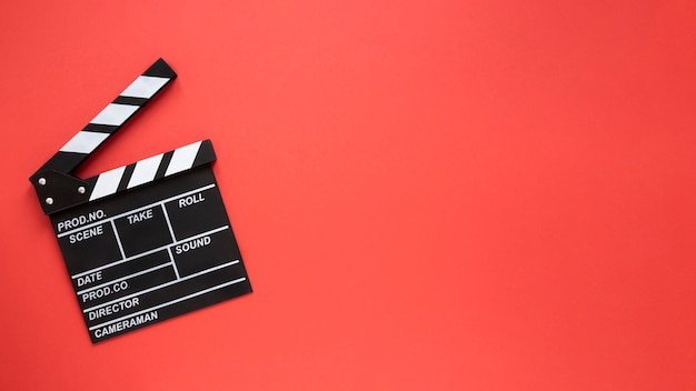 Movie clapper on red background with copy space Free Photo