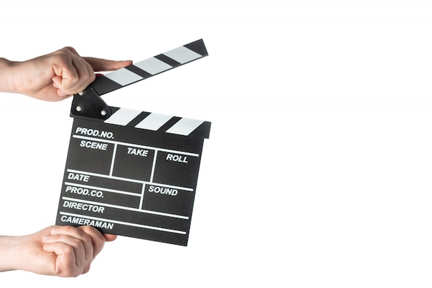 白い分離スペースに手で映画カチンコ Premium写真