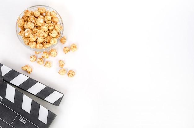 Movie clapperboard with popcorn Premium Photo