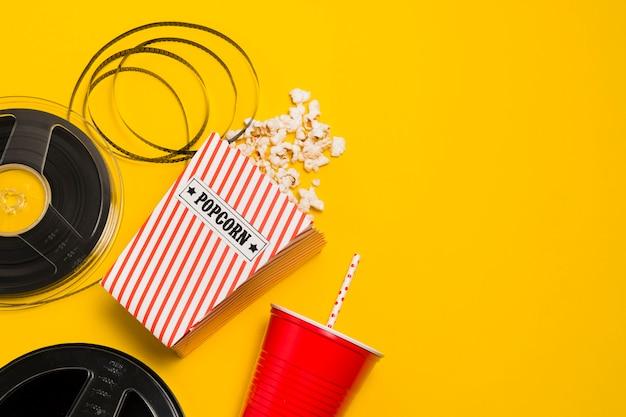 Movie roll and popcorn Free Photo