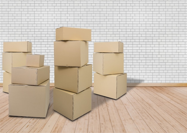 Moving in new home. empty room with carton boxes Premium Photo