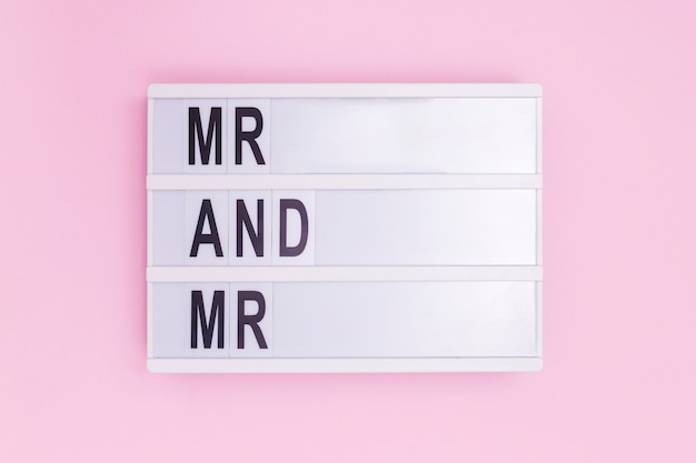 Mr and mr light box message on pink background Free Photo