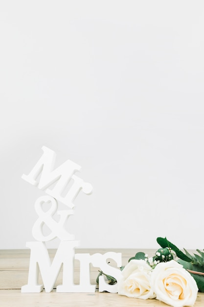 Mr and mrs with white roses Free Photo