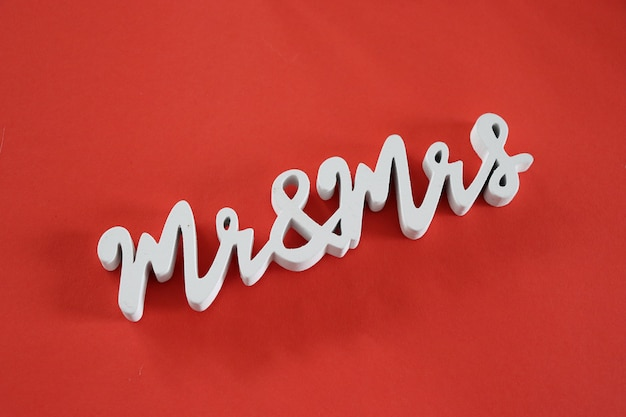 Mr and mrs words on red background Premium Photo