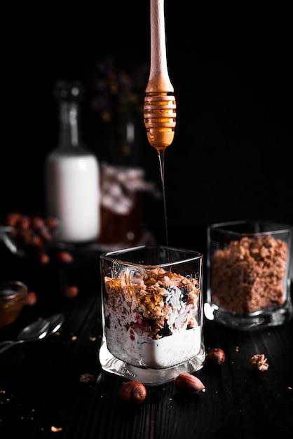 Muesli with honey and black background Free Photo