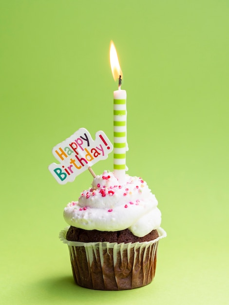 Muffin with candle and happy birthday sign Free Photo