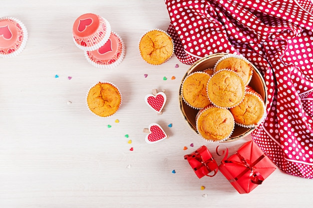 Muffins with pumpkin. cupcakes with valentine's day decor. flat lay. top view. Premium Photo