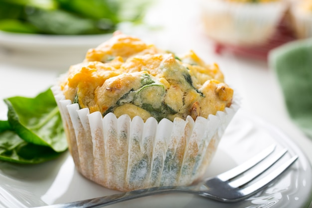 Muffins with spinach, sweet potatoes and cheese Premium Photo