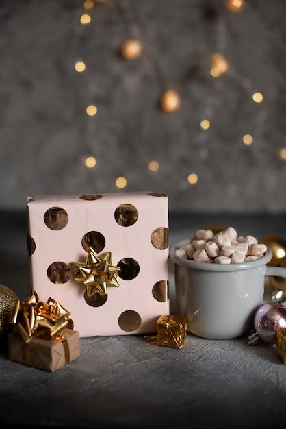 Mug for mockup near christmas tree and gift boxes Premium Photo