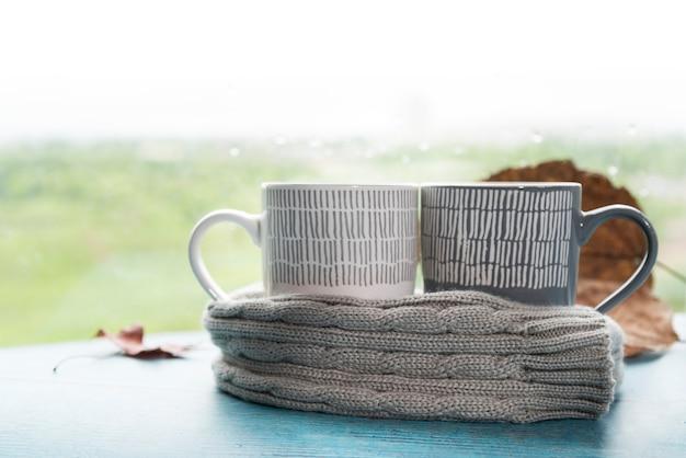 Mugs in warm scarf Free Photo