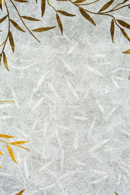 Mulberry paper texture with golden and silver leaf Premium Photo