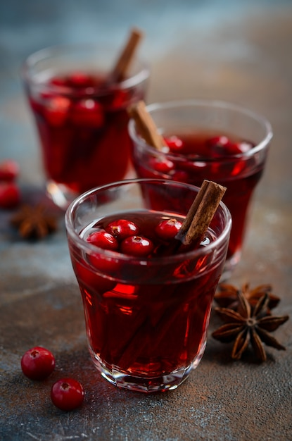 Mulled red wine with cranberries and spices. Premium Photo