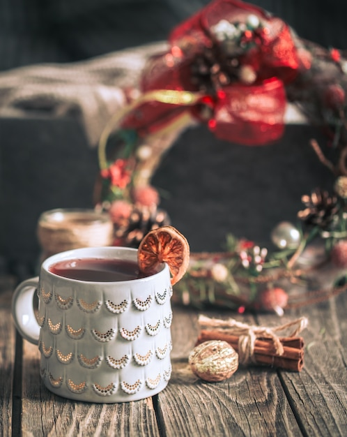 Mulled wine in a cup on a wooden background Free Photo