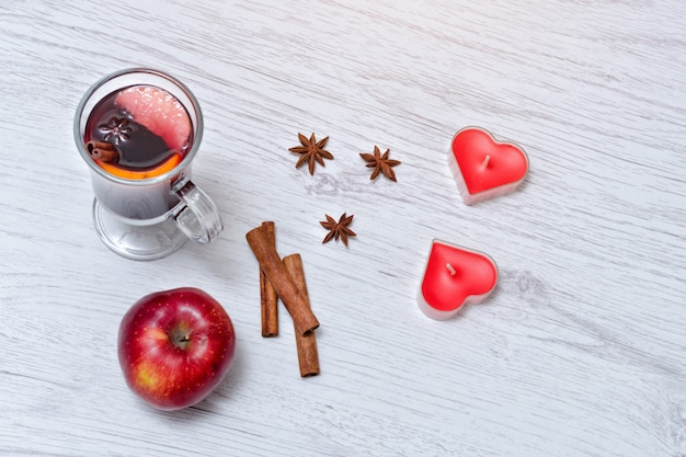 Mulled wine with spices on a lace napkin. Premium Photo
