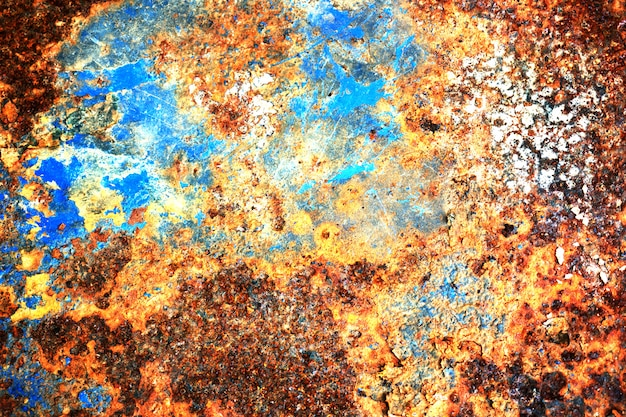 Multi colored background, rusty metal surface with blue point texture flaking and cracking Premium Photo