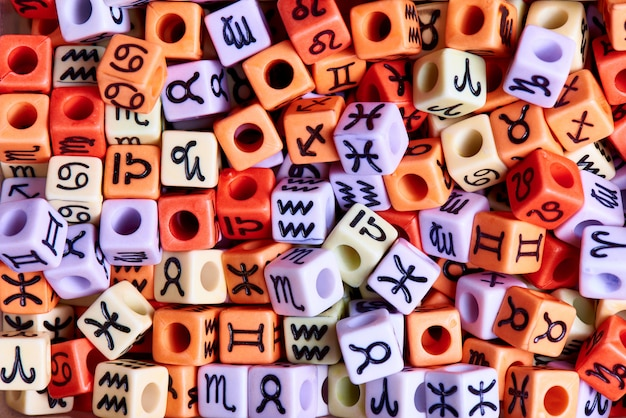 Multi-colored cubes with zodiac signs close-up. Premium Photo