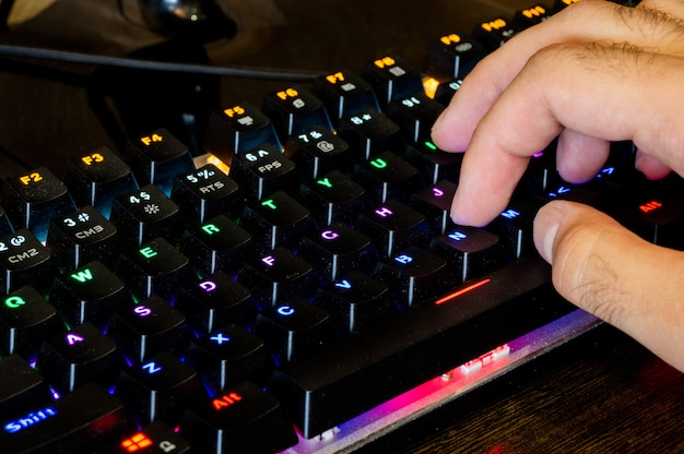 Multi-colored professional gaming mechanical rgb keyboard on the table Premium Photo