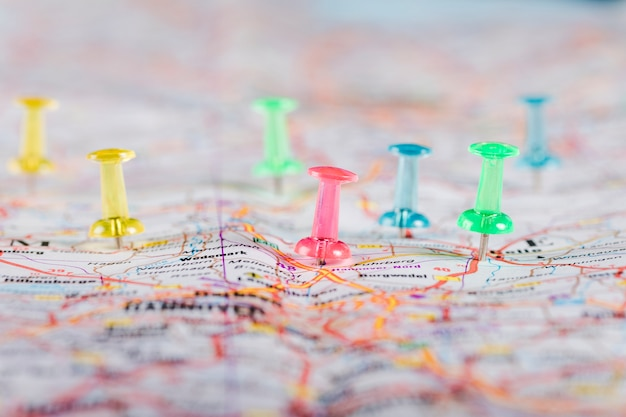 Multi colored pushpins pointing planned destinations on map Free Photo