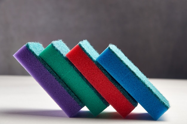 Multi-colored sponges for washing dishes close-up Premium Photo