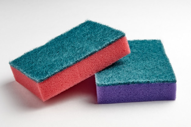 Multi-colored sponges for washing dishes on a light background close-up Premium Photo