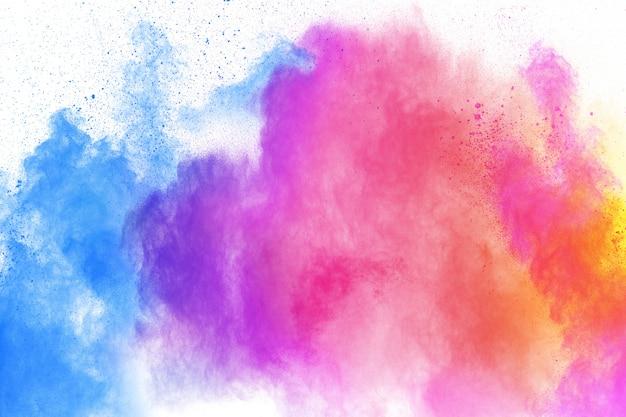 Multi colour powder explosion . launched colourful dust particles splashing. Premium Photo