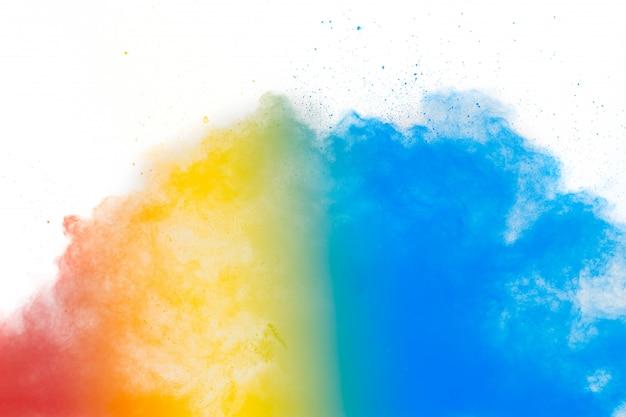 Красочная предпосылка пастельного взрыва порошка. multi покрашенный выплеск пыли на белой предпосылке. покрашенное holi. Premium Фотографии