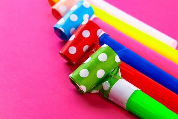 Multicolor party blowers. multicolored party whistles. decor for a birthday. Premium Photo