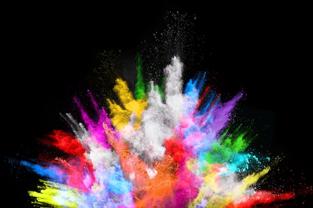 Multicolor powder explosion on black background. Premium Photo