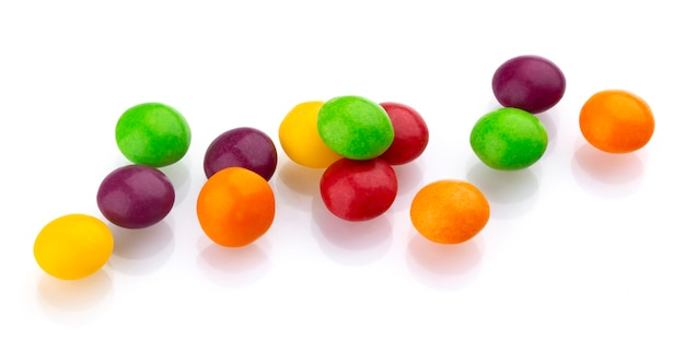 Multicolor shiny nuts and raisins dragee isolated on white background Premium Photo