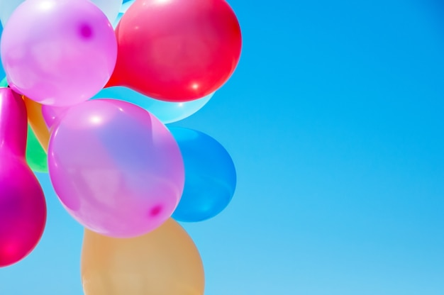 Multicolored balloons against the blue sky Premium Photo