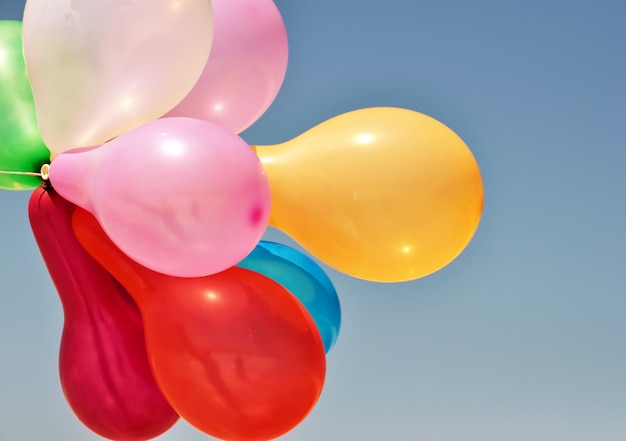Multicolored balloons on blue Premium Photo