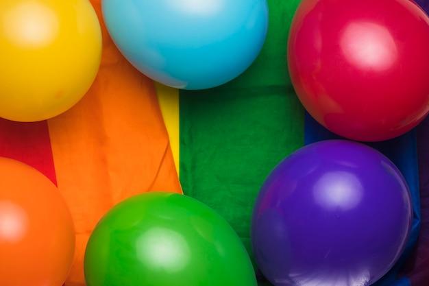 Multicolored balloons on rainbow cloth Free Photo