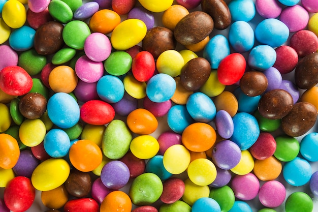 Multicolored candy buttons and drops Free Photo