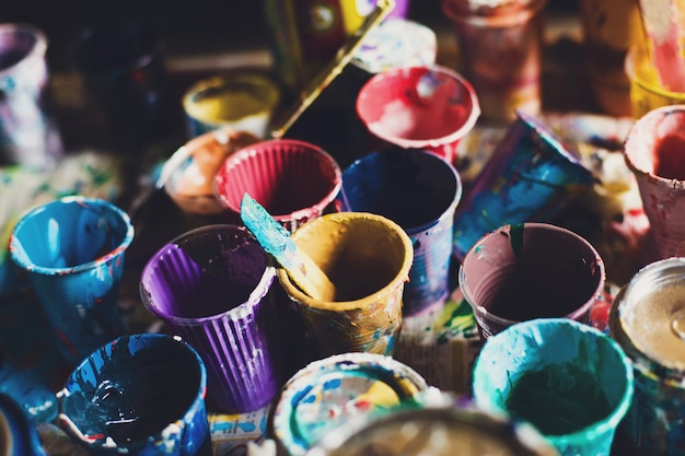 Multicolored cans with paint Premium Photo
