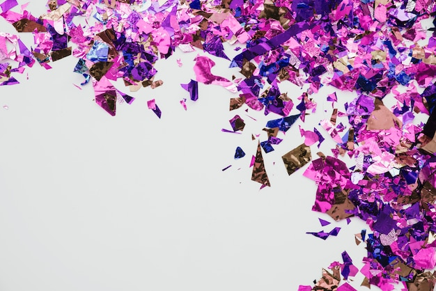 Multicolored confetti in abstract background Free Photo