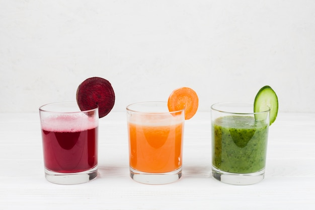 Multicolored drinks in glasses Free Photo