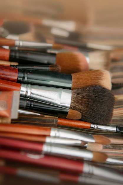Multicolored eye shadows with cosmetics brush Premium Photo